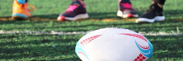Close up of a rugby ball on a field