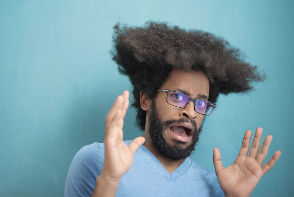 Scared man in front of blue background