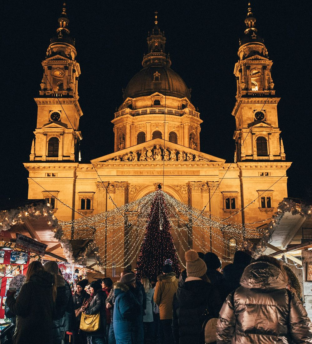 shoppers at an outdoor christmas market in prague