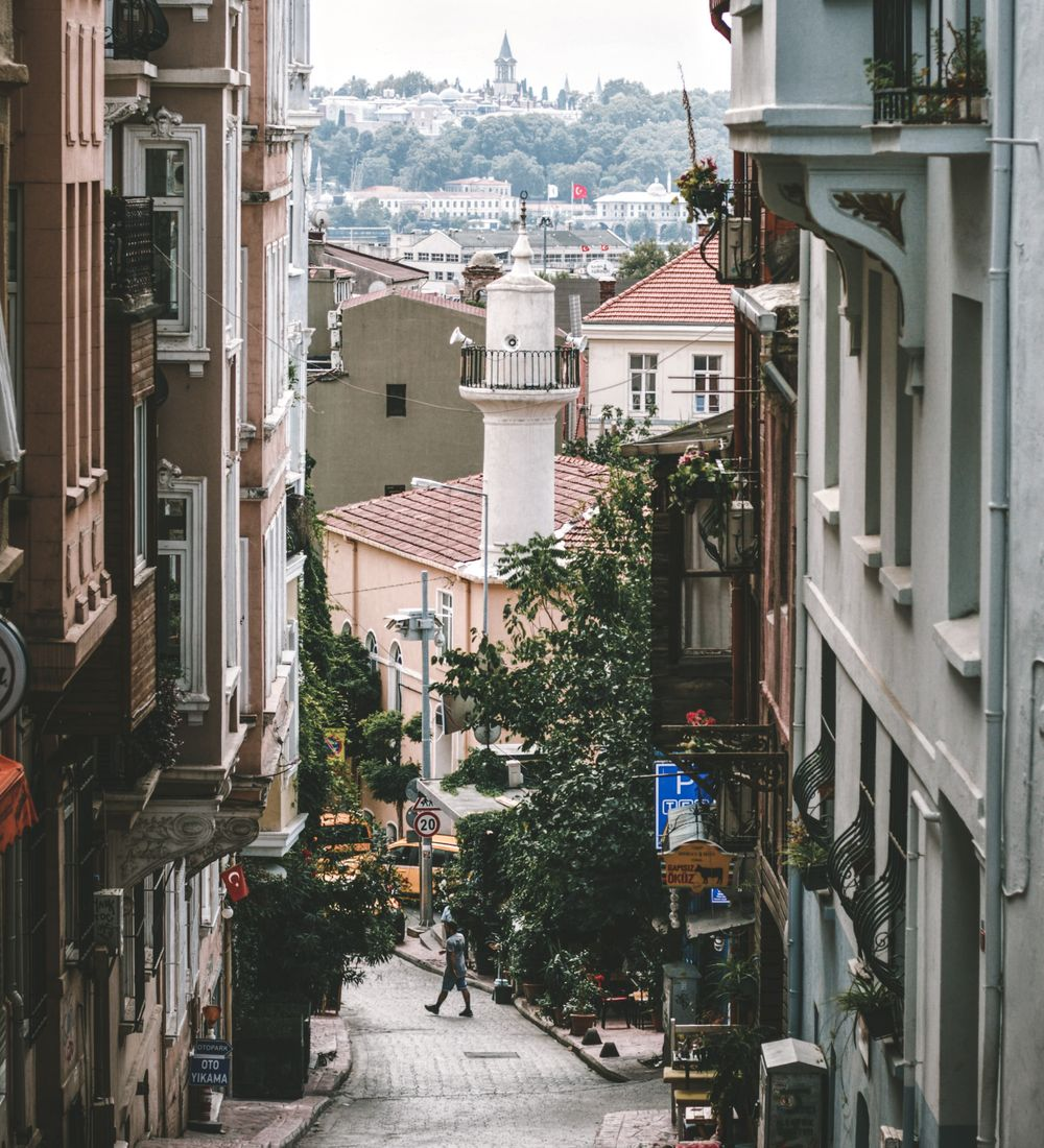 a street in istanbul with buildings of the city in the background