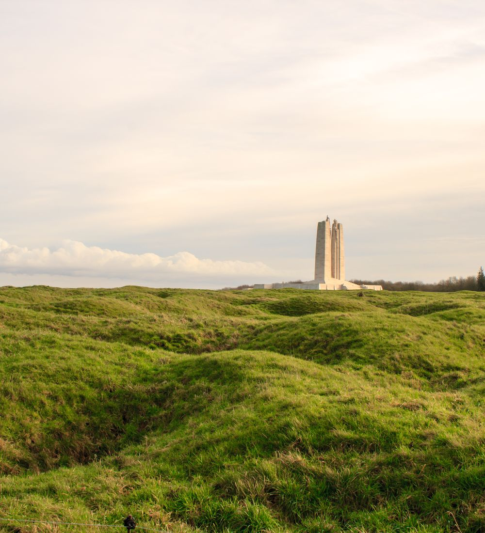 vimy ridge memorial with shell craters in the foreground