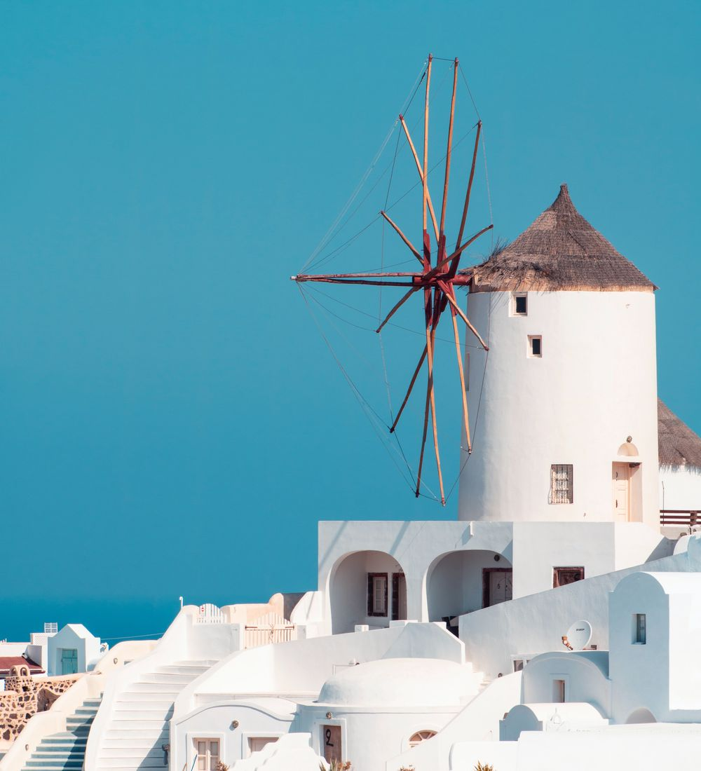 traditional whitewashed windmill in the greek islands