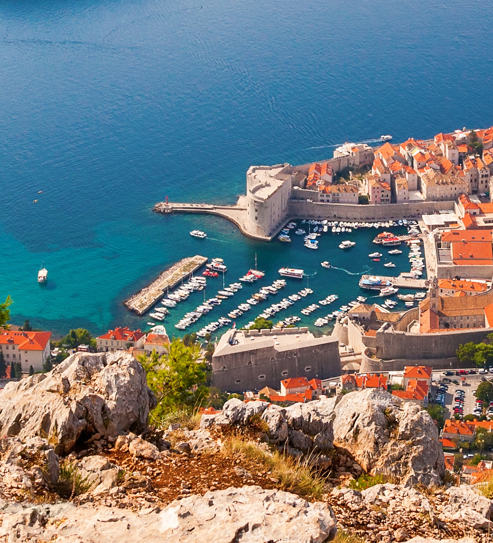 aerial view of red roofed buildings of dubrovnik along coast