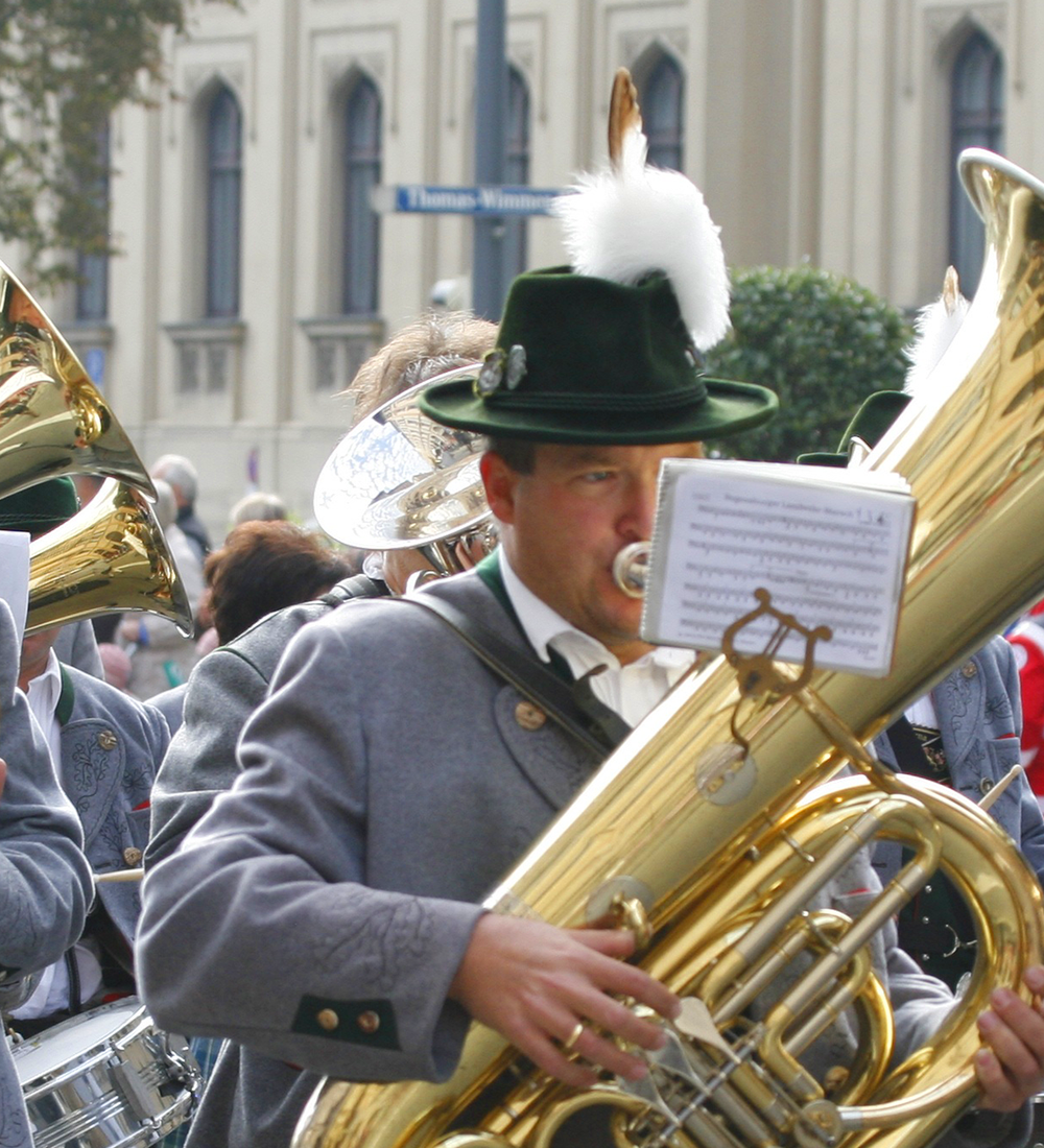 german musicians playing trombones in parade