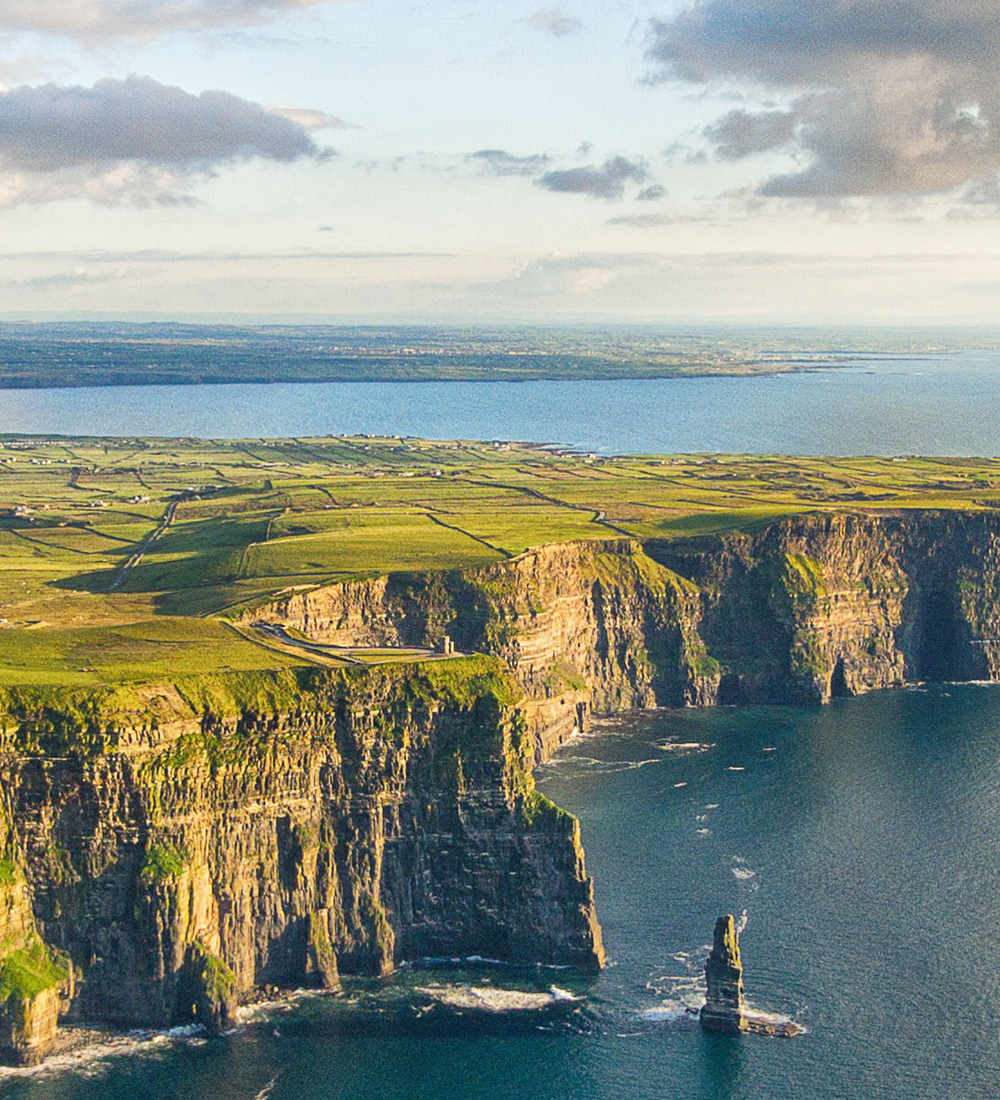 aerial view of cliff of moher in ireland on sunny day in