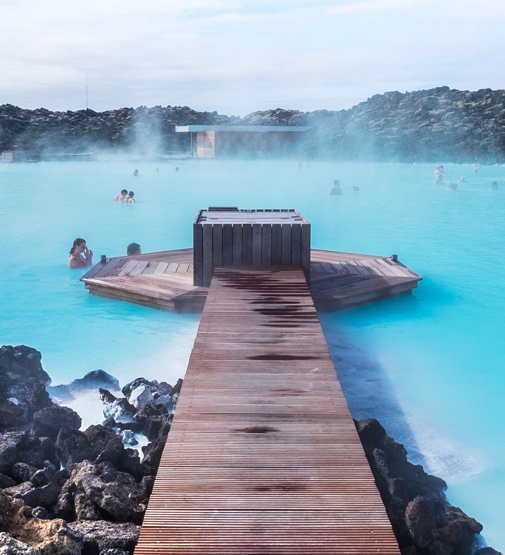 people swimming in the blue lagoon spa in iceland