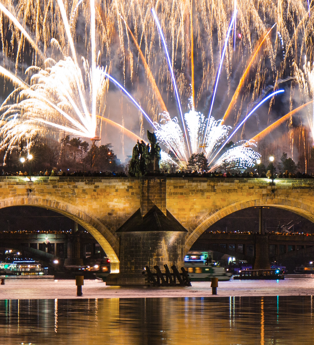 colorful fireworks over charles bridge and vltava river