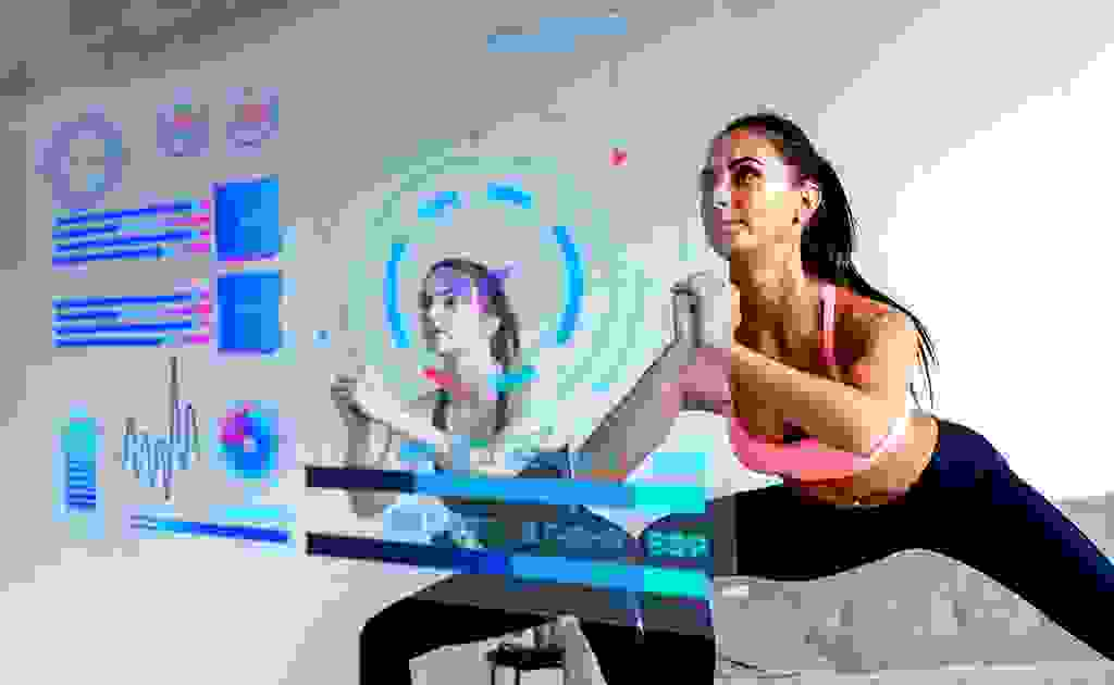 2 women workout looking at the vital stats on a digital screen
