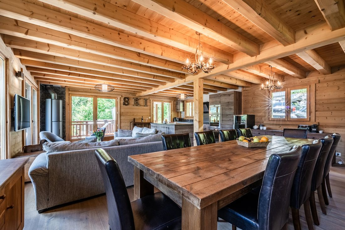 Modern living room with fully-equipped open kitchen at Balata luxury chalet in Morzine