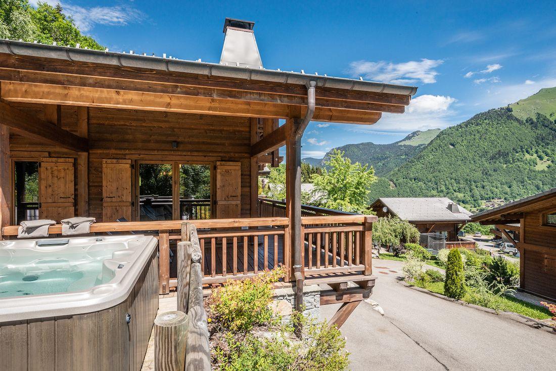 Outdoor hot tub overlooking Morzine's valley at Balata luxury chalet in Morzine