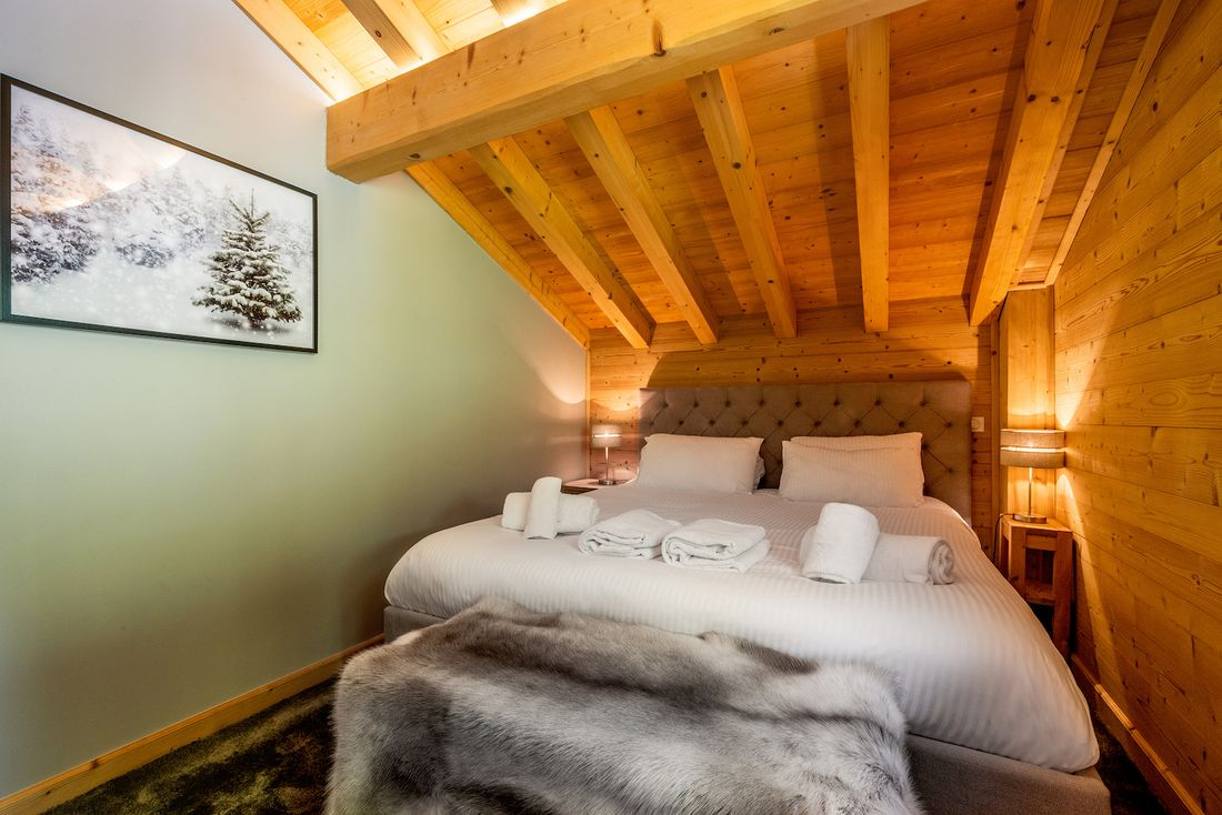 Ensuite bedroom with photographs of the French Alps at Balata luxury chalet in Morzine