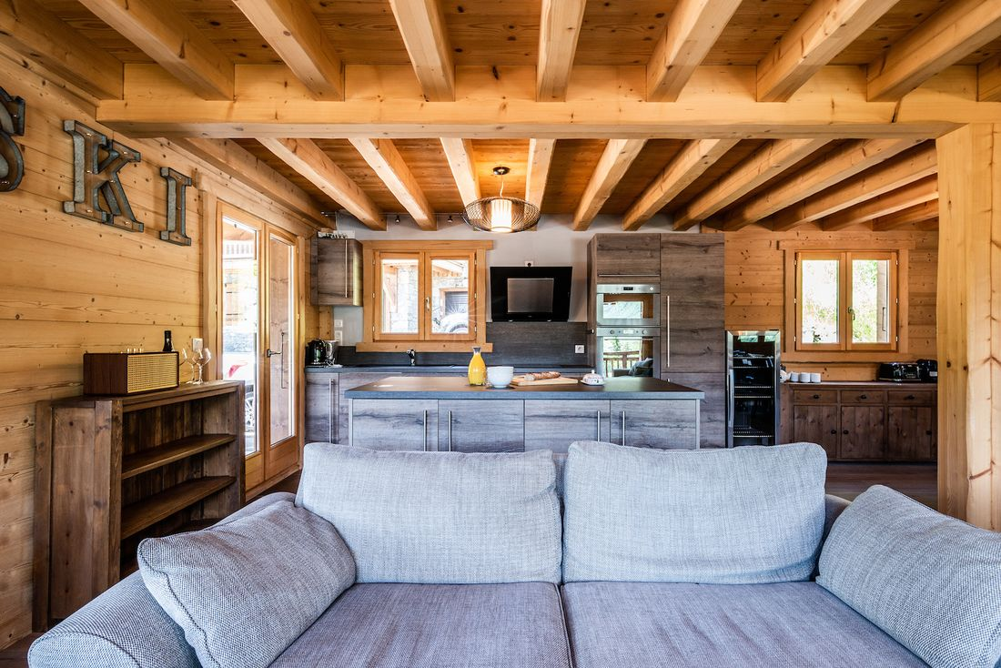 Fully-equipped modern kitchen and living room at Balata luxury chalet in Morzine