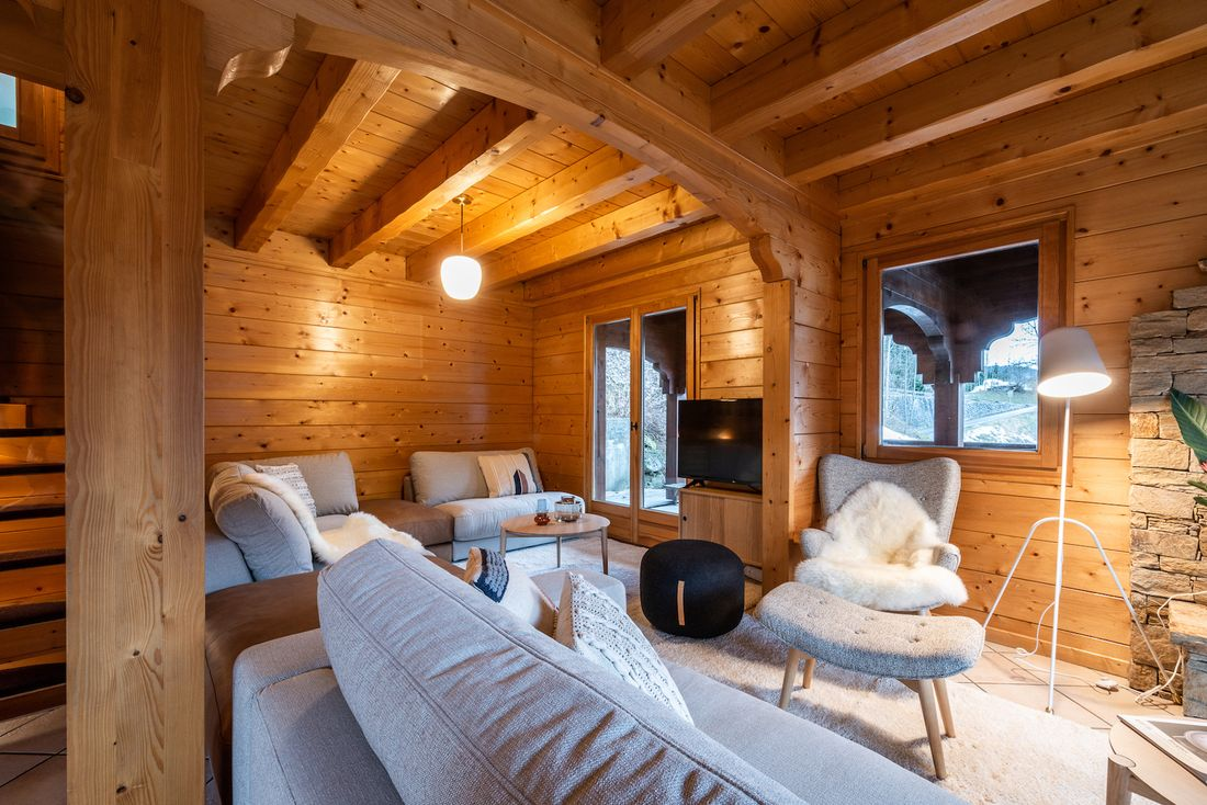 Cosy living room with TV at Doux Abri chalet in Morzine