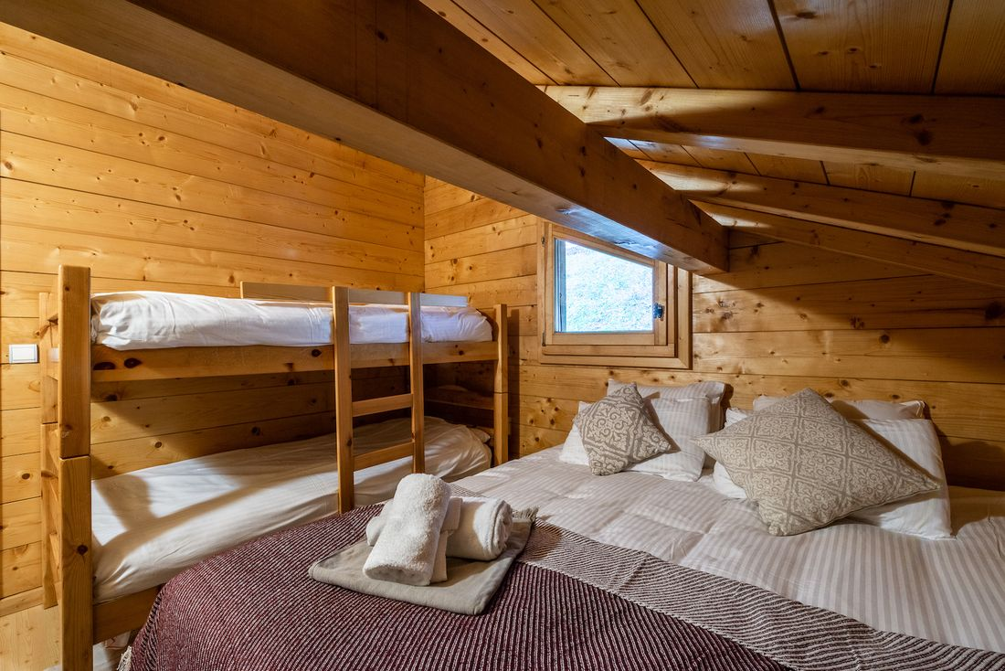 Bunk beds and double bed at Doux Abri chalet in Morzine