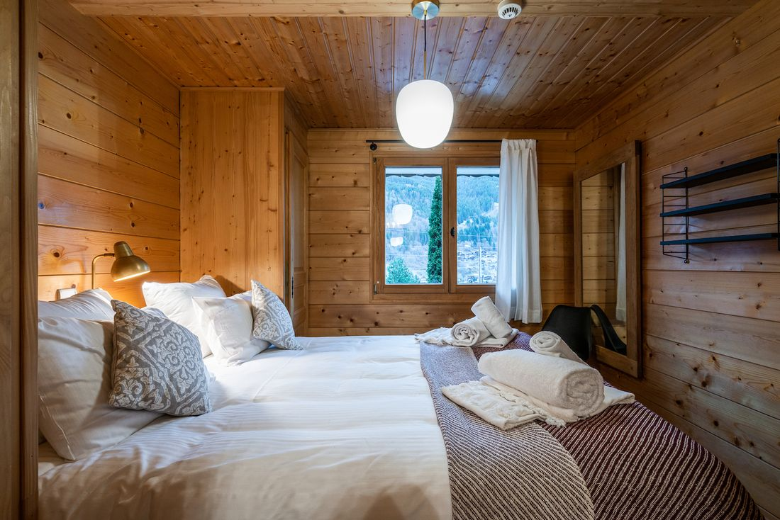 Double bedroom with mountain views at Doux Abri chalet in Morzine