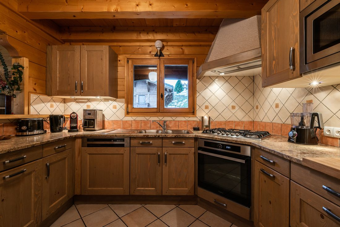 Open fully-equipped kitchen with Nespresso machine at Doux Abri chalet in Morzine