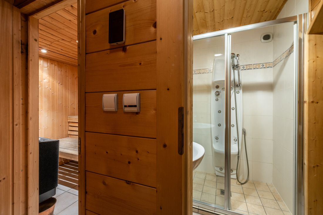 Wooden sauna and massage shower at Doux Abri chalet in Morzine