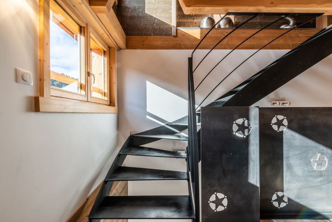 Wrought iron staircase with star details at Etoile accommodation in Morzine