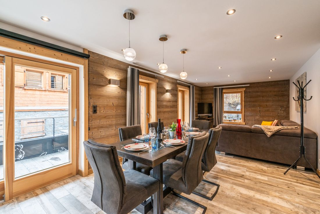 Modern dining room and living room at Ourson accommodation in Morzine
