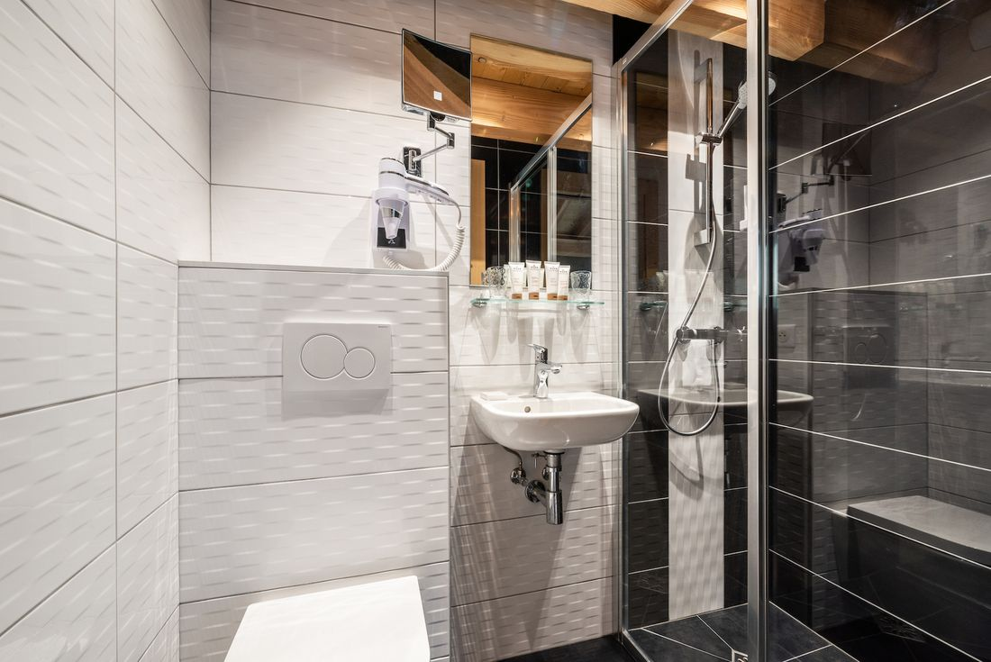 Modern black and white bathroom with shower at Etoile accommodation in Morzine