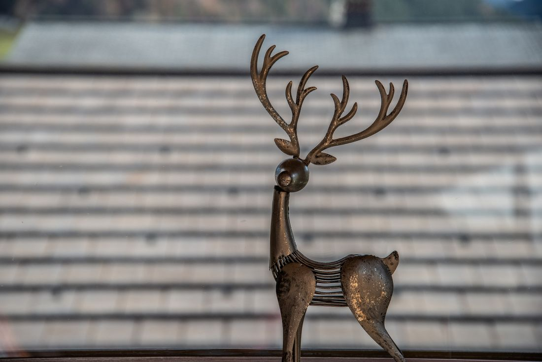 Wrought iron reindeer statue at Street view of Etoile accommodation in Morzine