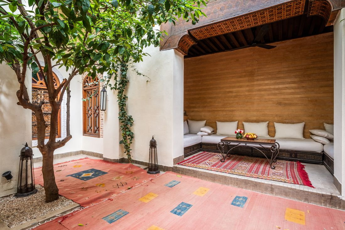 Patio of Adilah riad in Marrakech featuring berber rugs and lemon trees