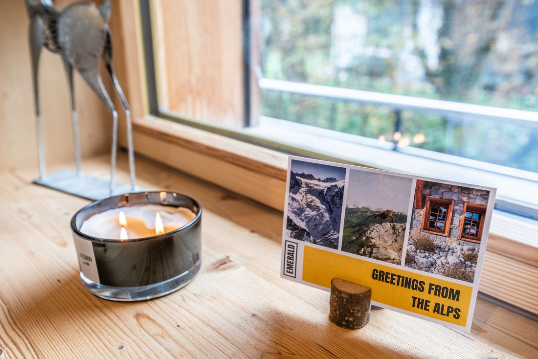 Jasmin candle with a postcard at Ourson accommodation in Morzine