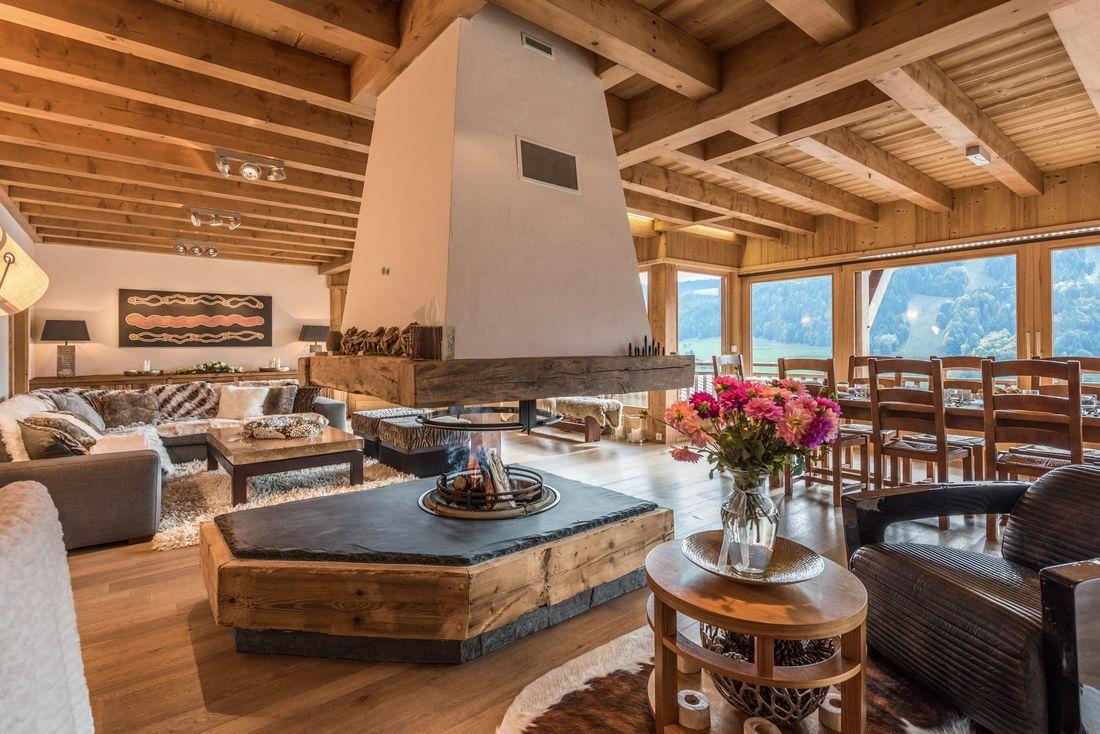 Wood and slate chimney in the living room of Omaroo II luxury chalet in Morzine