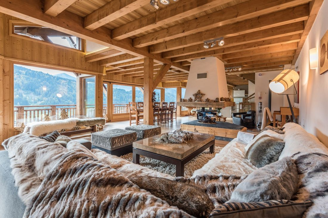 Traditional wooden living room with furry blankets at Omaroo II luxury chalet in Morzine