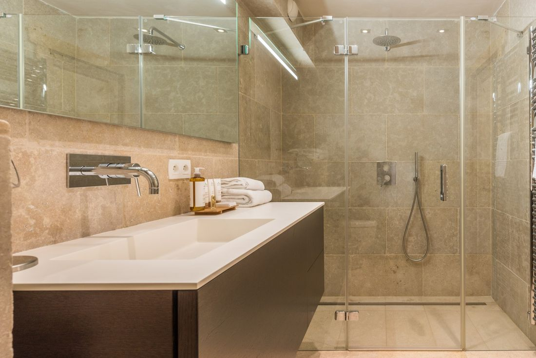 Beige bathroom with shower