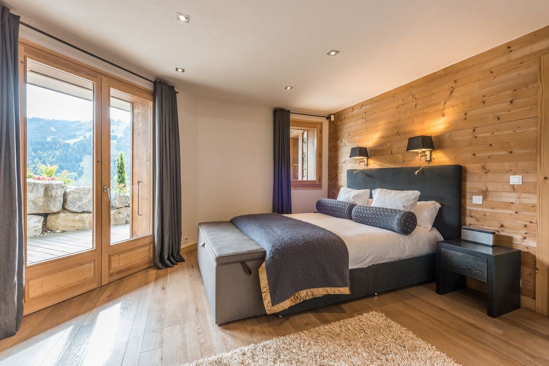 Double bedroom with views over the Alps at Omaroo II luxury chalet in Morzine