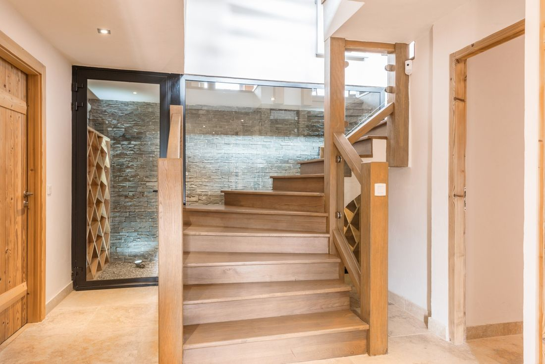 Wooden staircase at Omaroo II luxury chalet in Morzine