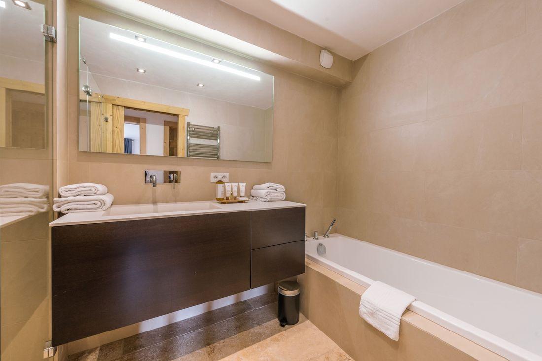 Beige bathroom with bathtub