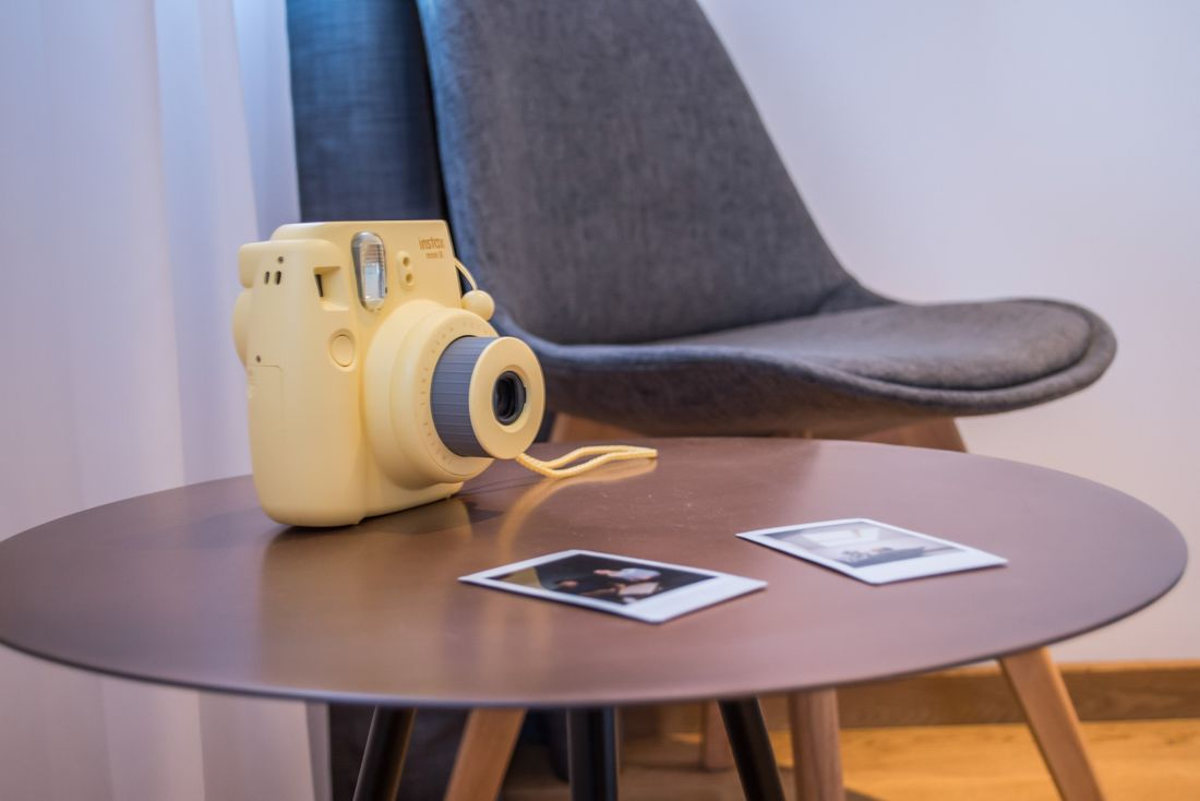 Yellow Polaroid on a wooden table at Agba accommodation in Morzine