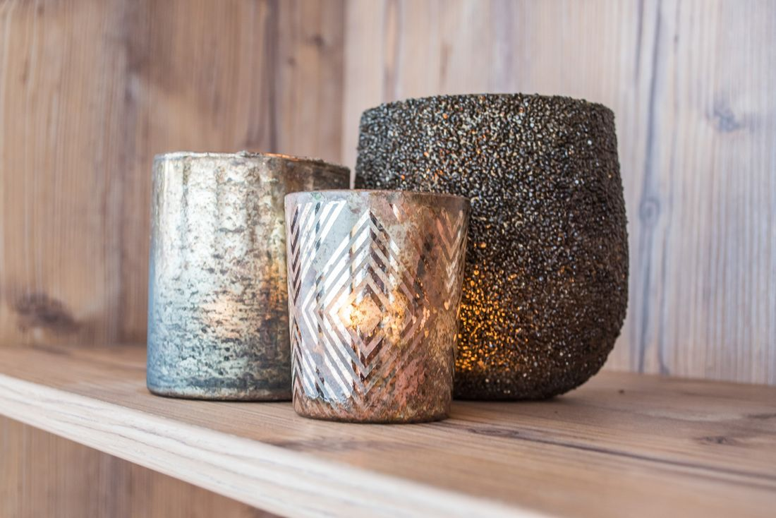 Three metallic candles