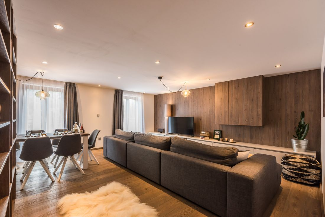Modern living room and dining table at Sugi accommodation in Morzine