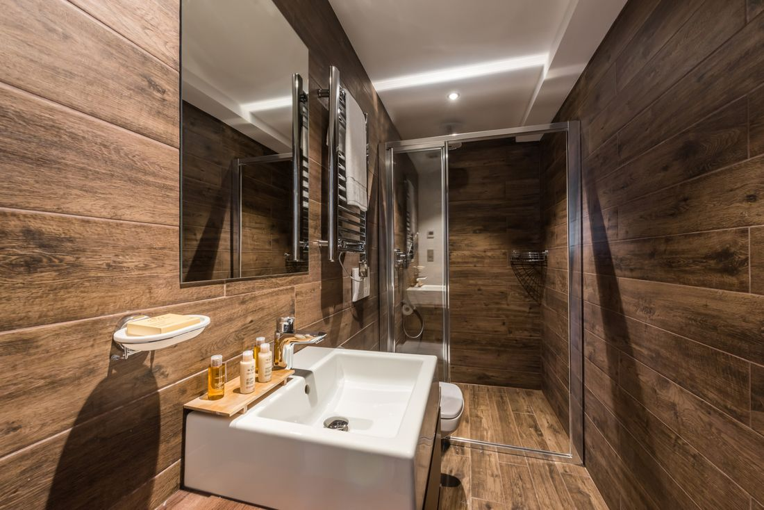 Wooden bathroom with complimentary Nuxe products at Catalpa accommodation in Morzine