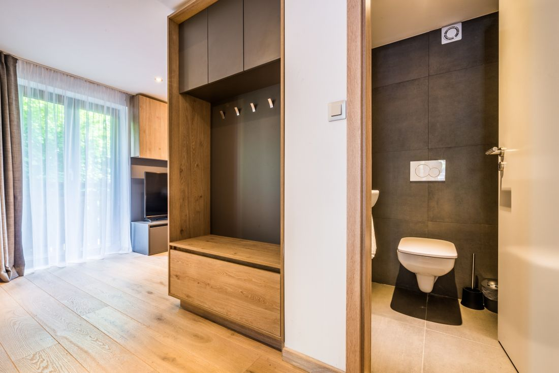 Wooden living room and toilet room at Karri accommodation in Morzine