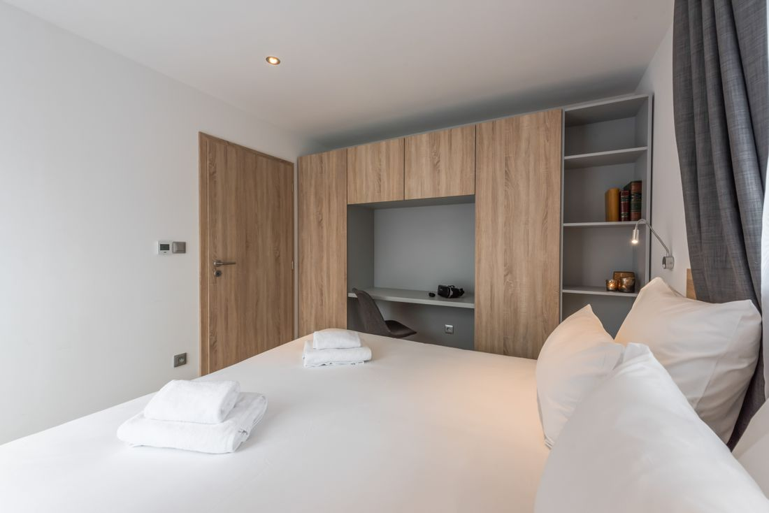 Double bedroom with fresh towels at Meranti accommodation in Morzine