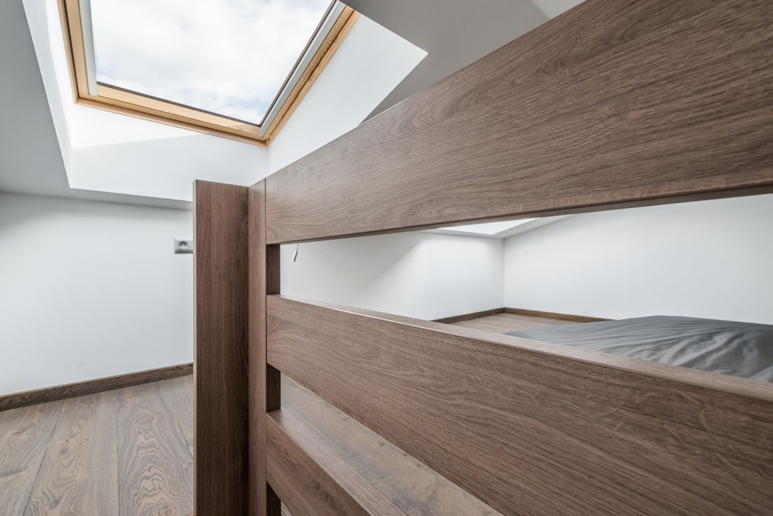 Bunk beds bedroom with roof window at Kauri accommodation in Morzine