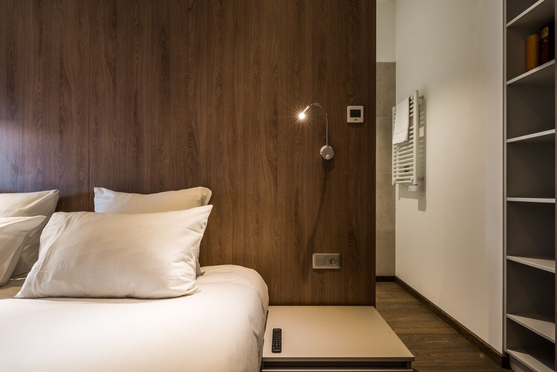 Double bedroom with wooden walls at Kauri accommodation in Morzine