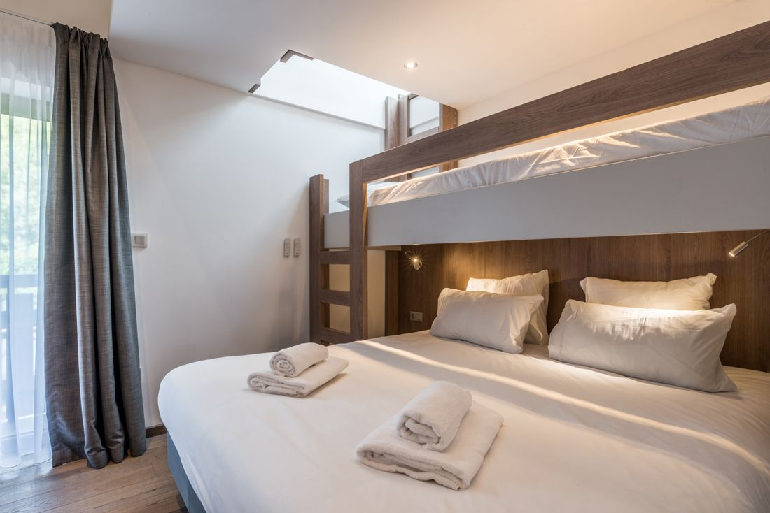 Double bed and mezzanine at Kauri accommodation in Morzine
