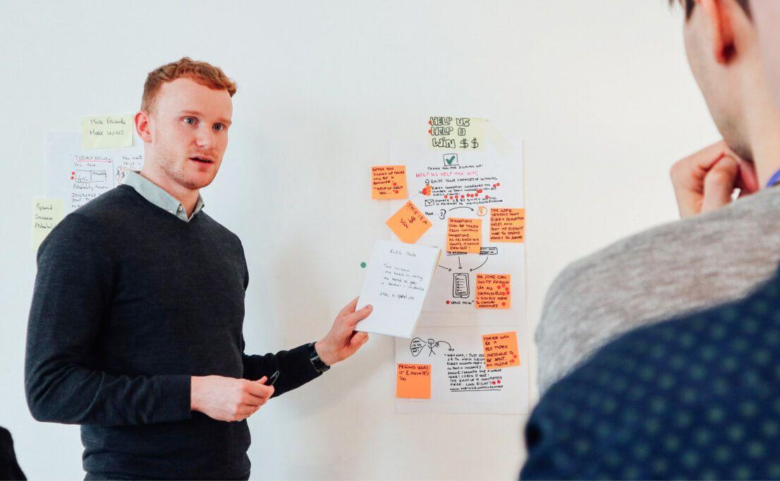 Sam Ducker explains a concept during a design sprint