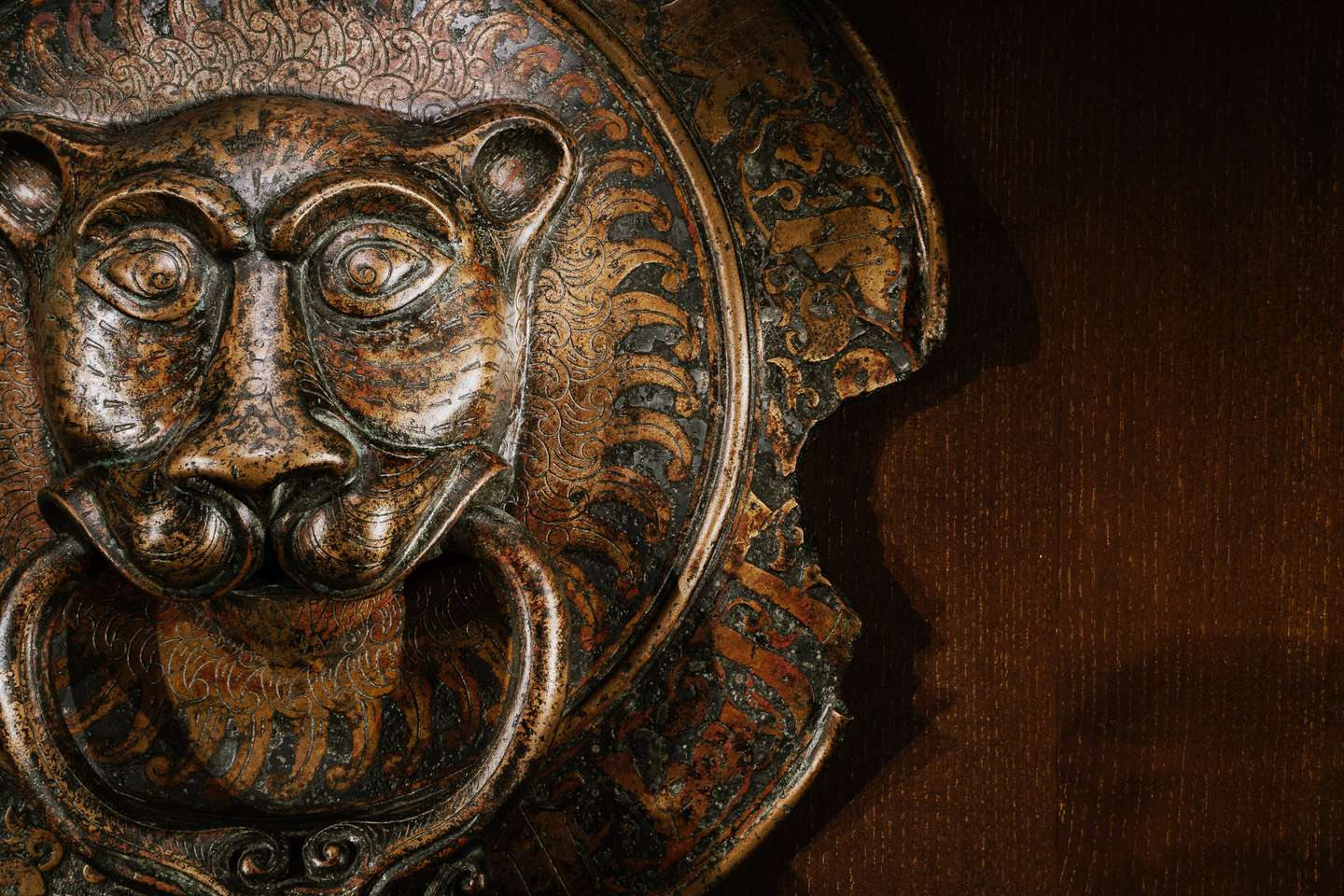 A door knock of bronze, which looks like a lion with a ring and with a rooster in the mouth, Sicily, 11th century.