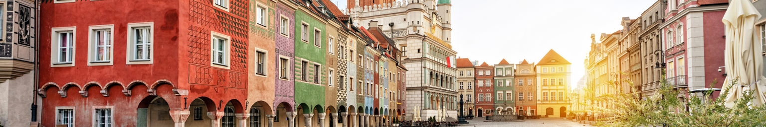 Rynek square with small colorful houses and old Town Hall in Poznan, Poland