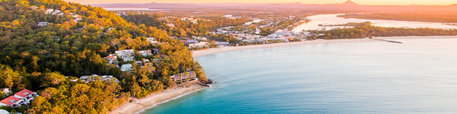 Noosa Heads National Park from an aerial perspective at sunset.