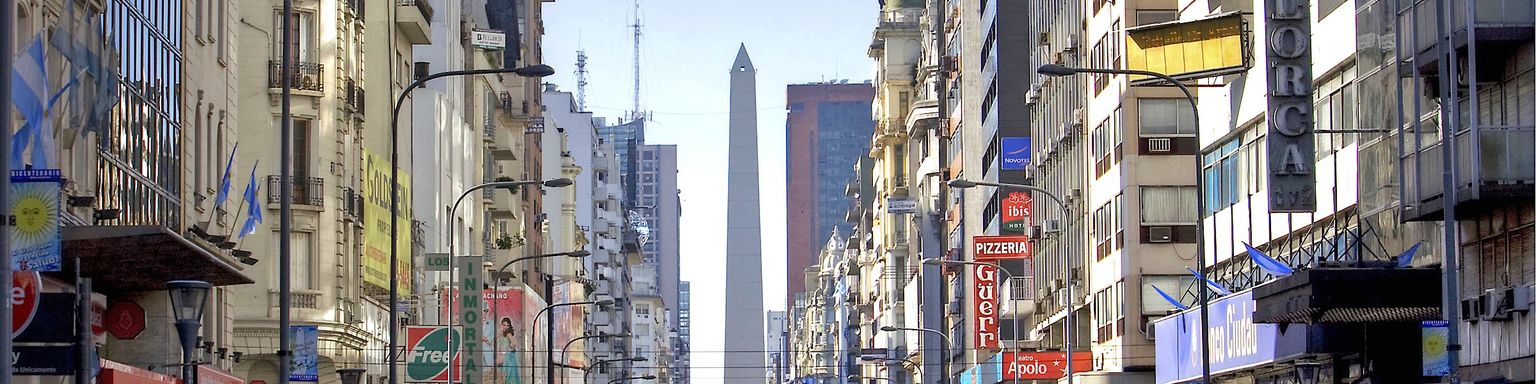A streetscape of Buenos Aires with the Argentinian obelisk in the background