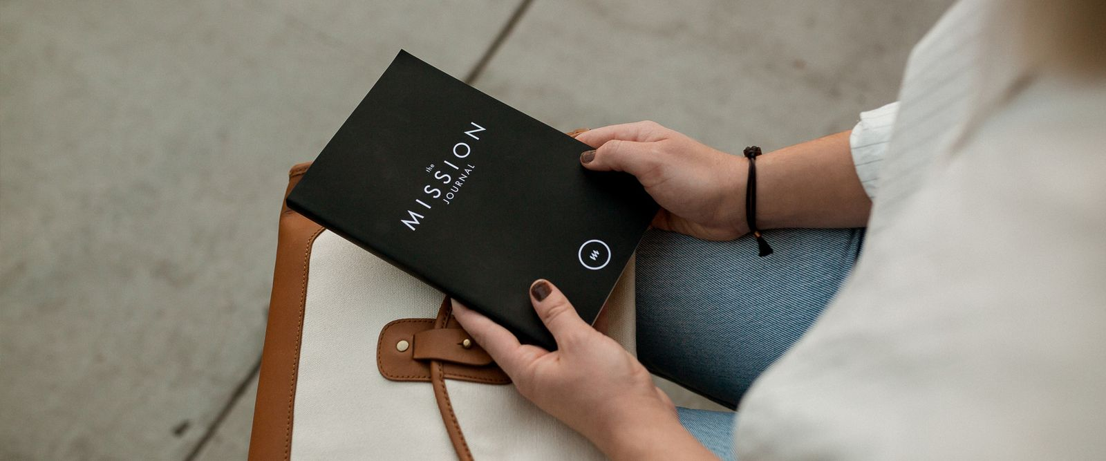 Woman holding a black book in her hands