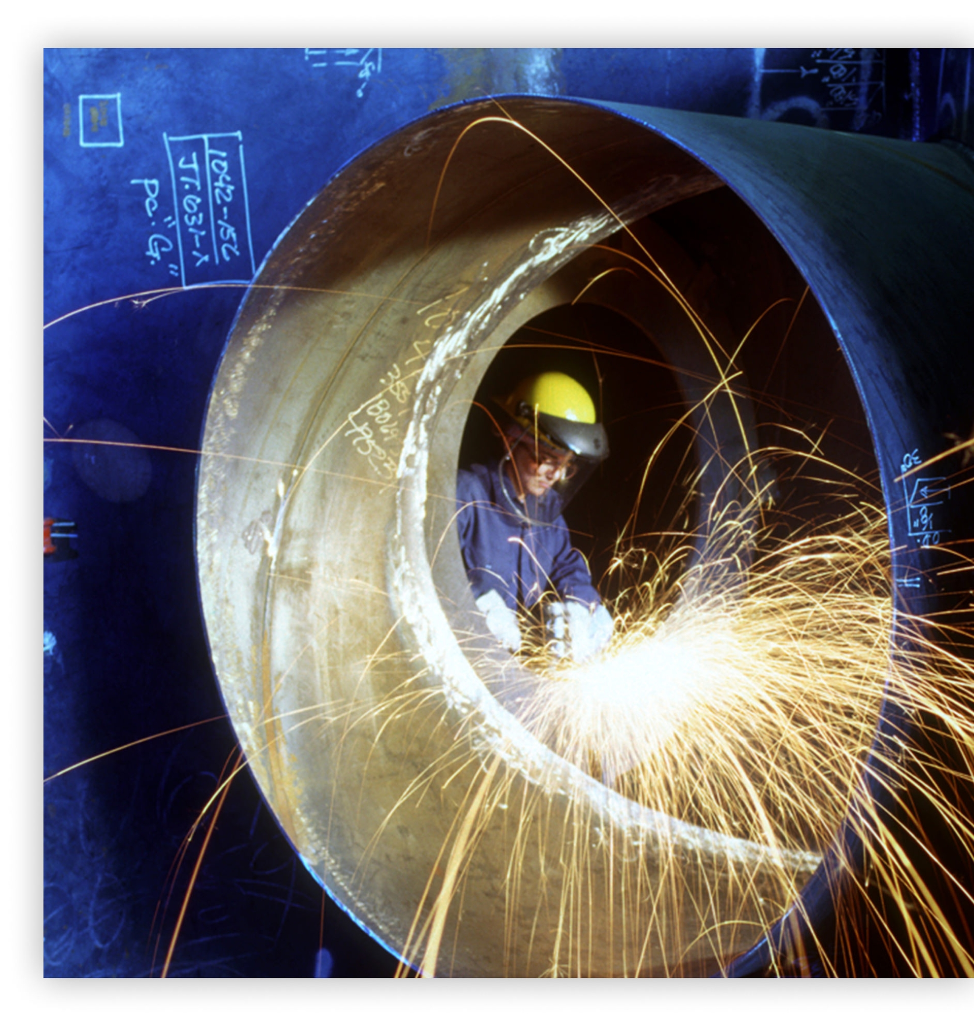 Woman welding on a mechanical project for commercial projects