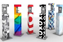 Various hand sanitizers with different colorful and playful designs are placed across a white space.